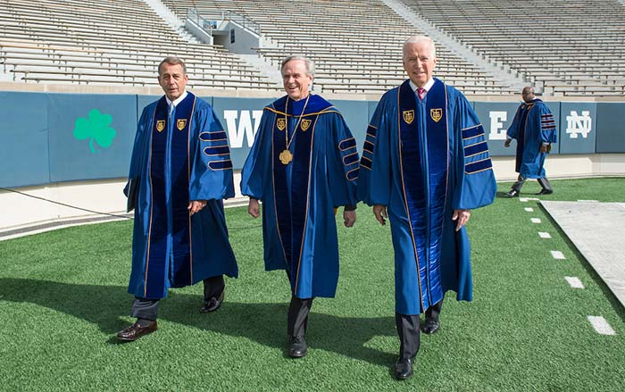 University of Notre Dame president Rev. John Jenkins, C.S.C. is flanked by Laetare Medal recipients, John Boehner, former Speaker of the House and Vice President Joe Biden as they walk to the stage for the 2016 Commencement Ceremony.