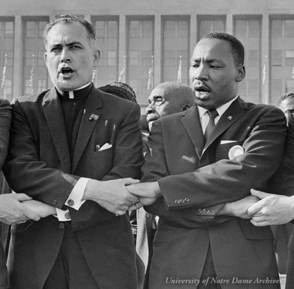 Rev. Theodore M. Hesburgh with Martin Luther King Jr., Rev. Edgar Chandler (far left), and Msgr. Robert J. Hagarty of Chicago (far right) at the Illinois Rally for Civil Rights in Chicago's Soldier Field.
