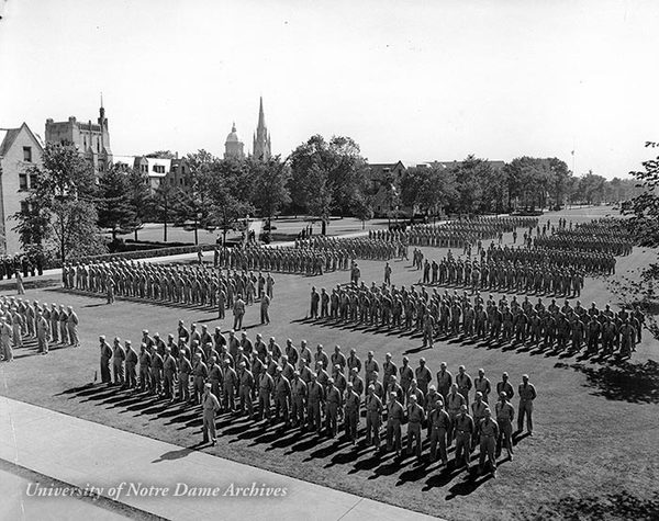Naval V-7 Military Training Units in formation on South Quad during World War II, 1942.