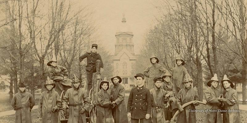 Notre Dame Fire Department firemen posed on Main Quad in front of Main Building, c1899.